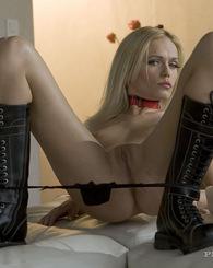 Schoolgirl skirt and boots blonde babe posing legs wide open