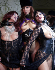 Three fetish ladies in leather playing with the same dick