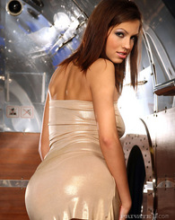 Perfect glamorous babe in elegant dress posing and shows ass