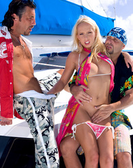Amazing blond teenager having wild sex with two guys on boat