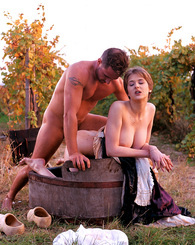Horny babe in classic costume in between the grape harvest