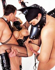 Enormous tit dominatrix fucks two bondaged suspended guys