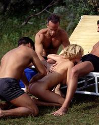Three guys on jet ski fucking this blond babe by the beach