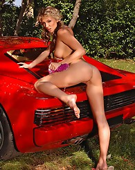 Stunning blonde washing car