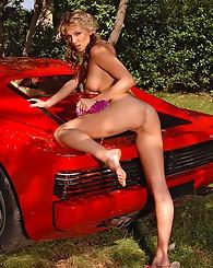 Stunning blonde washing car